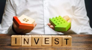 "Wooden blocks with ""invest"" written on them"